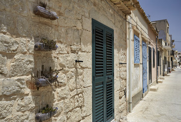 Italy, Sicily, Sampieri, old stone houses on the seafront