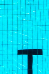 Swimming pool bottom with letter T