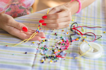 Making bracelet of colorful beads