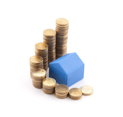 Blue house with stack of coins