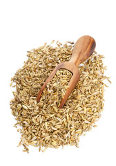 Fennel seed heap with wooden scoop