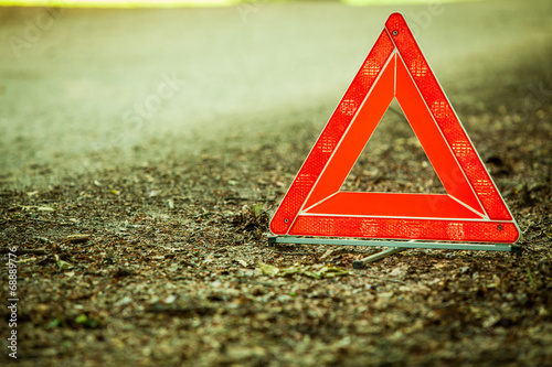 Breakdown of car. Red warning triangle sign on road - 68889776