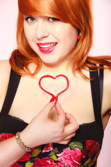 Girl holding valentine red heart love symbol. Valentines day.