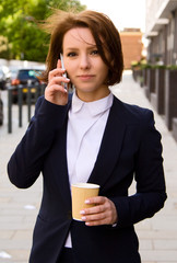 business woman with phone and coffee.