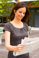 young woman reading the paper.