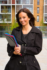 young woman holding folders.