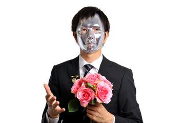 銀色の仮面を被ったスーツのビジネスマン