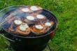 Grilling steaks at summer weekend