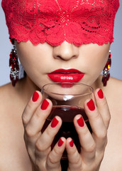 Woman in red ribbon and wine