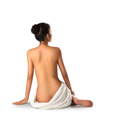 Asian woman wearing towel sitting on the floor