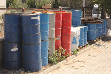 collection of old toxic 50 gallon drums