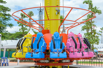 Seats of free fall tower in amusement park