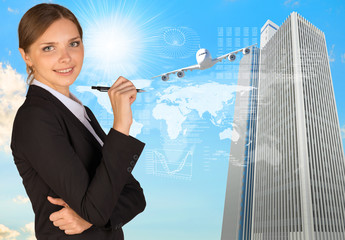 Businesswoman with pen looking at camera