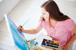 Artist paints picture on canvas
