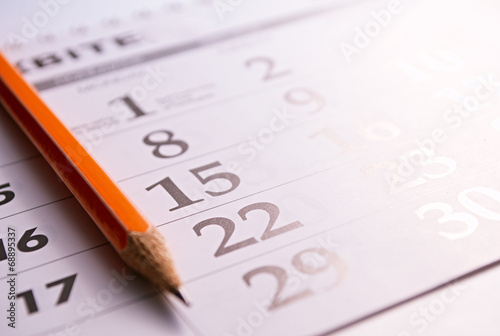 Close-up of a pencil on the page of a calendar - 68895337
