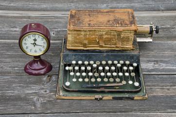 antique typewriter, vintage clock and old book Bible