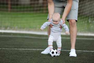 the kid learns to play a ball