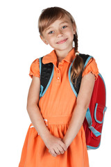 Cute schoolgirl with a red backpack on her shoulders