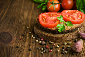 rustic food : sandwiches of rye bread with tomato and basil