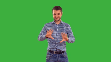 man showing copy space on  green background