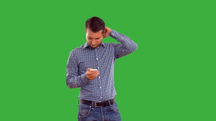 man writes message with serious face on a green background