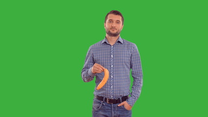 man shows copy space and enjoys on a green background