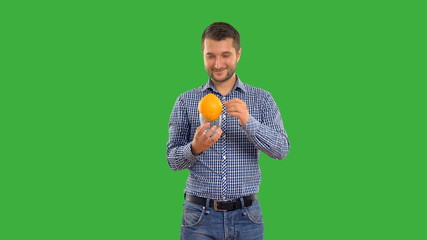 Young adult man showing focus  on green background