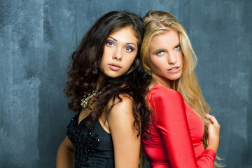 Beautiful young women on a dark background