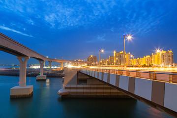 Bridge to the Palm Jumeirah island in Dubai at night, UAE
