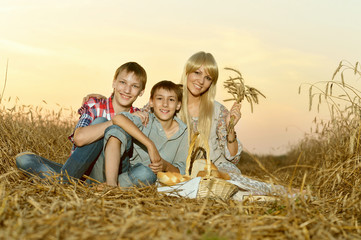 Mom with sons on wheat field