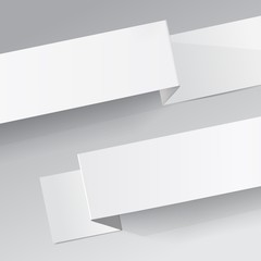 white diagonal sheets of paper on a grey background.