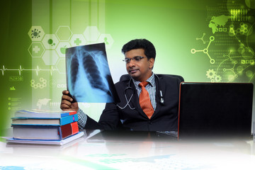 male doctor looking at x-ray