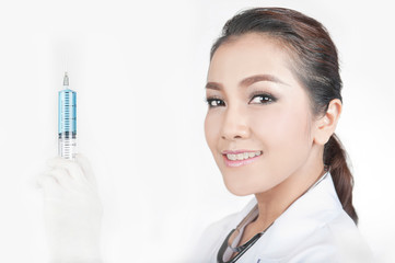 confidence female doctor smiling and holding an syringe