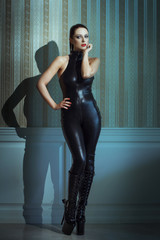 Sexy woman posing in latex catsuit