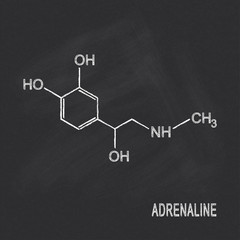 Chemical formula of adrenaline chalked on blackboard