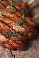 two hot juicy pork steak with thyme vertical close-up
