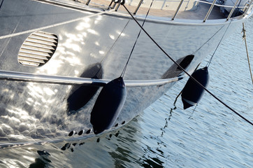 Two boat fenders, protecting the side of a sailing vessel