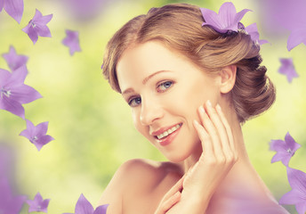 Beauty face of beautiful girl with purple and lilac flowers