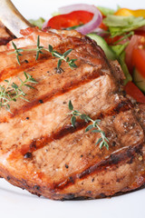 Grilled pork macro and salad with vegetables vertical