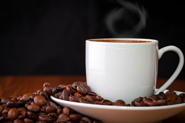 cup of coffee against dark background