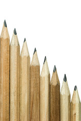 Wooden pencils on white background.