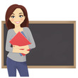 Cute student with books in front of blackboard