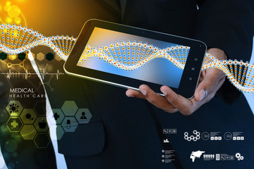 Smart hand showing tablet pc with DNA interface