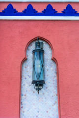 Moroccan lantern on wall.