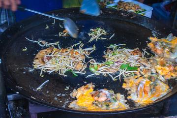 Detail of food preparation at Ampahwa floating market