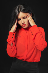 Business woman in red in depression