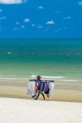 Salesman walking on the beach..