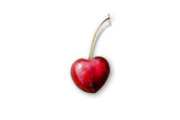 Heart-shaped cherry isolated on white