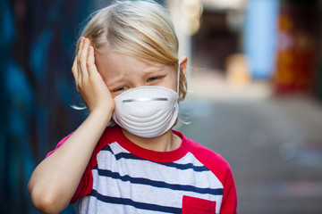 Sick boy wearing face mask