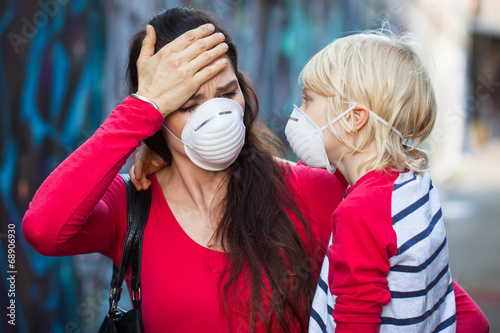 Woman and son wearing face masks - 68906930